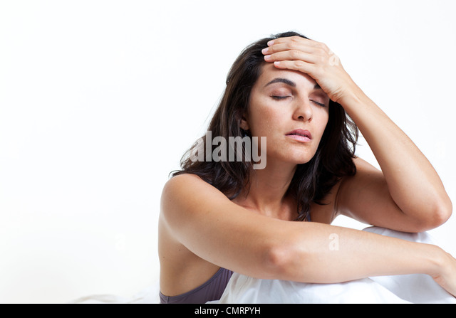 Beautiful woman suffering from headache - Stock Image