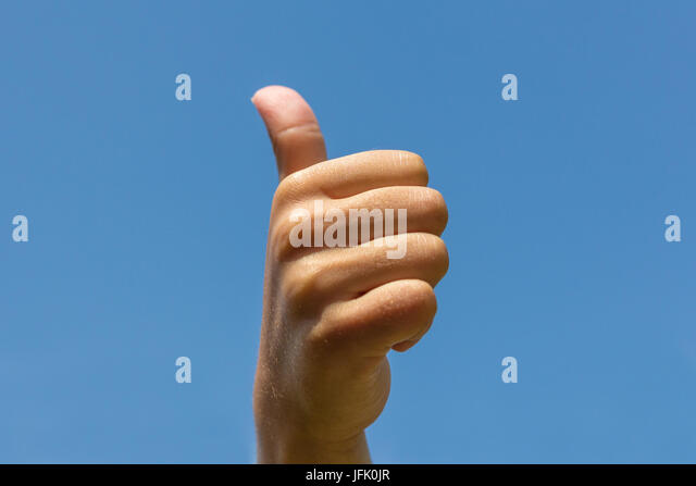 thumbs up , hand showing thumb up - Stock Image
