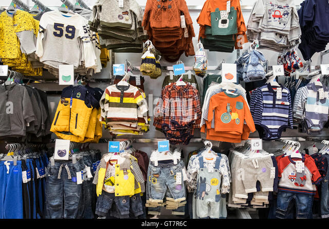Childrens clothing on display in a Morrisons supermarket. - Stock Image