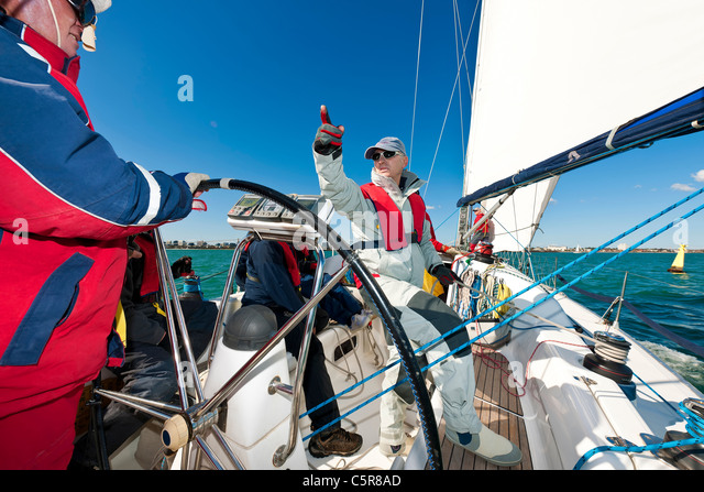 An Offshore Yacht crew getting ready to race. - Stock-Bilder