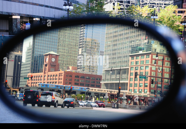 USA Illinois Chicago rear view mirror reversed image downtown Chicago Wacker Drive traffic CTA rapid transit train - Stock Image