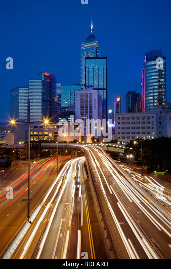 High rise building and car trails at night in Central Hong Kong, China. - Stock Image