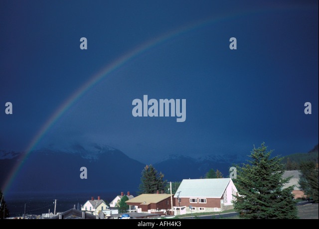 Alaska Rainbow over Haines dark moody sky - Stock Image