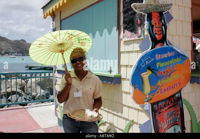 Sint Maarten Great Bay Philipsburg Dutch Black female sample drink - Stock Image