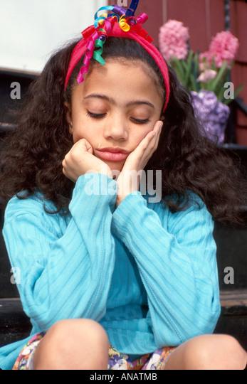 New Jersey Teaneck Black girl unhappy tear sad emotion - Stock Image