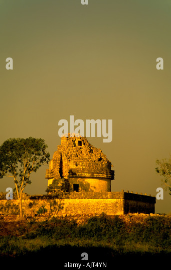 The observatory, El Caracol or snail, landmark temple at Chichen Itza Maya Ruins, Yucatan Mexico in warm golden - Stock Image