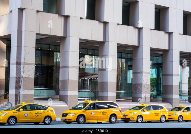 California CA Los Angeles L.A. Downtown One California Plaza South Grand Avenue taxi yellow cab minivan car - Stock Image