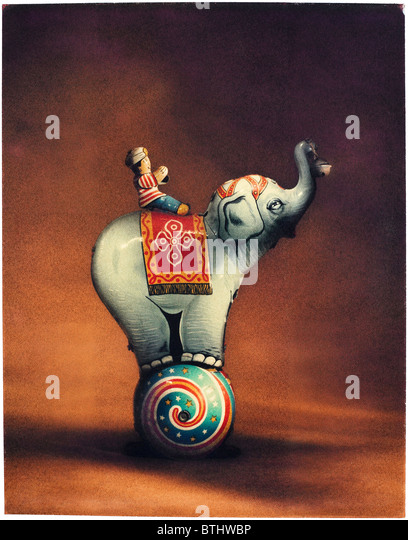 Polaroid transfer of tin toy elephant with rider. - Stock Image