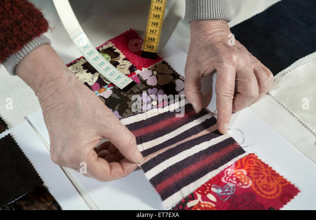 Senior female fashion designer working in workshop Bavaria Germany - Stock Image