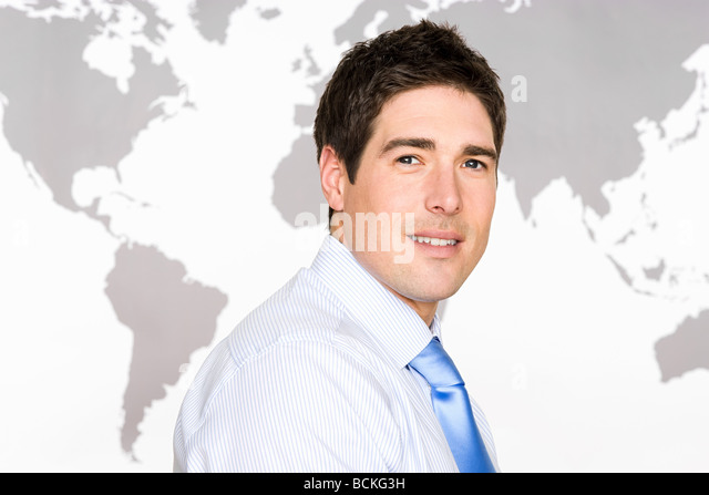 Businessman and world map - Stock Image