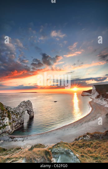 Durdle Door at sunset, Dorset. - Stock-Bilder