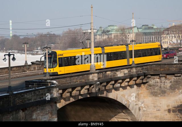 Bendy bus crossing the Augustus bridge (Augustusbrucke) in Dresden, Germany. - Stock Image