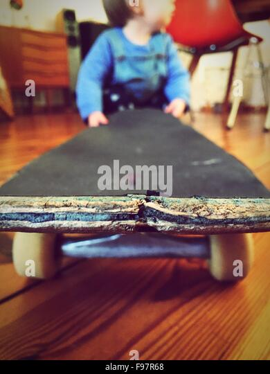 Baby Playing With Skateboard At Home - Stock-Bilder