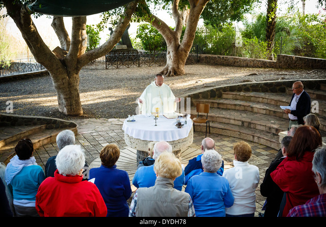 Mass by the Church of the Primacy of St. Peter in Tabgha by the Sea of Galilee, Israel. - Stock Image