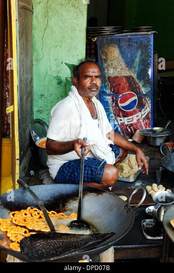 an-indian-man-cooking-street-food-dpd07b