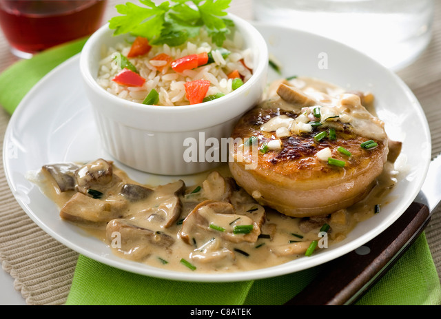 Veal Grenadin with mushrooms and cream sauce - Stock Image