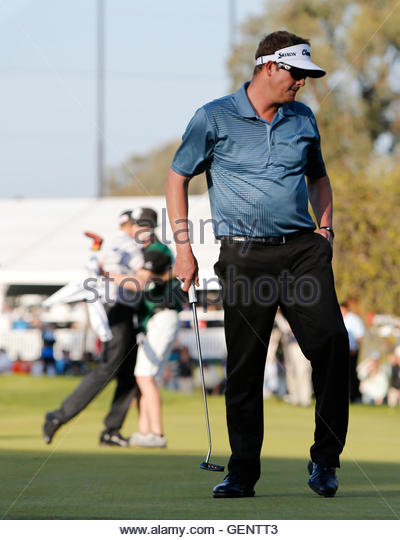 Charlie Beljan (R) of the U.S. reacts to missing a putt on the 10th green while John Merrick (rear L) of the U.S. - Stock Image