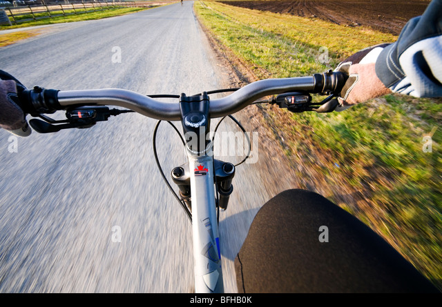 First person view of a cyclist riding on the Lochside Trail, Victoria BC. - Stock Image