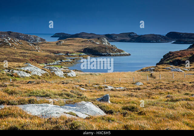 Sunny view craggy landscape and lake, Loch Aineort, South Uist, Outer Hebrides - Stock Image
