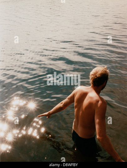 A Scandinavian man taking a swim. - Stock Image