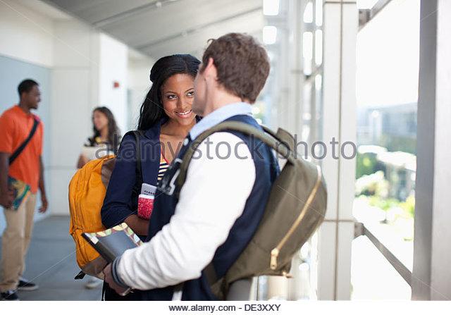 Students talking in school hallway - Stock Image