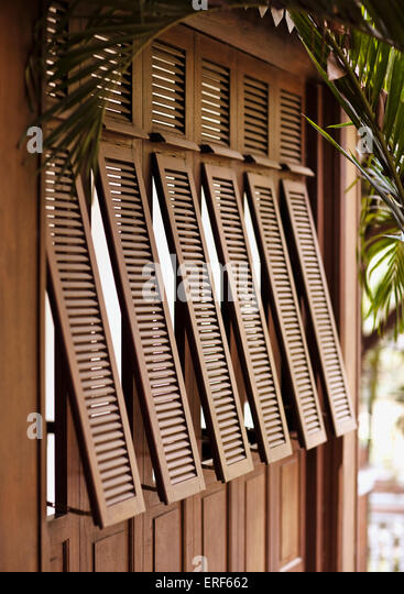 An exterior shot of French-style shutters at La Residence d'Angkor, Siem Reap, Cambodia. - Stock-Bilder