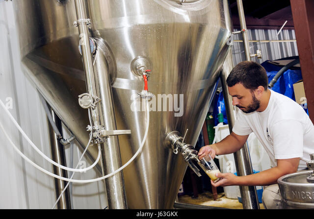 Michigan Baroda The Round Barn Winery Distillery and Brewery beer stainless steel vat microbrew hand-crafted testing - Stock Image