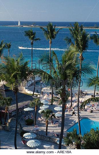 Bahamas New Providence Nassau British Colonial Hotel pool palms - Stock Image