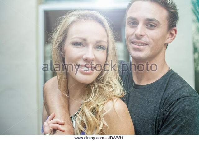 Portrait of young romantic couple - Stock-Bilder