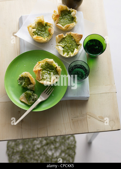 Plate of puff pastries with herbs - Stock Image