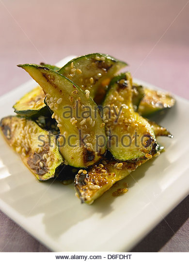 Sliced Courgette with sesame seeds - Stock Image