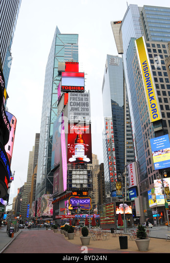 The Historic Times Square in New York City with tall billboards advertising well known brands. - Stock Image