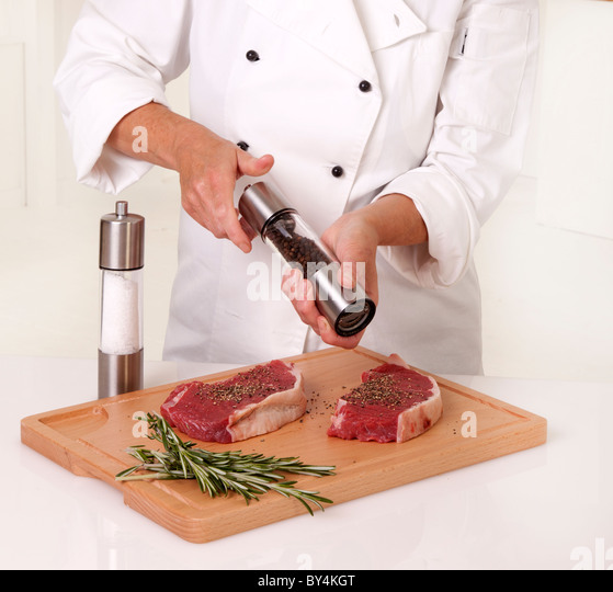 CHEF SEASONING FRESH BEEF STEAK - Stock Image
