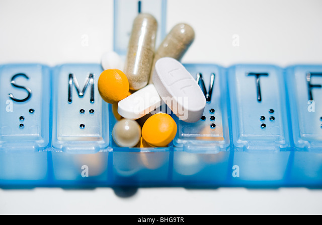 Pillbox with lots of tablets - Stock Image