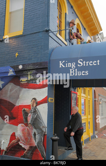 Virginia Alexandria Old Town Alexandria King Street Blues bar mural awning business whimsical decor blue paint entrance - Stock Image