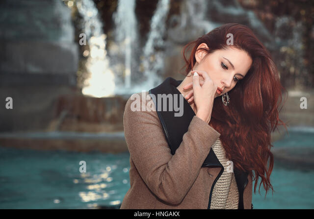 Beautiful red haired woman . Autumn emotional portrait - Stock Image