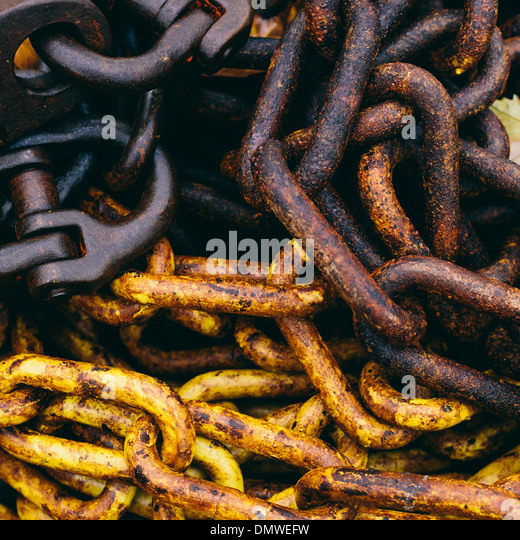 Close up of industrial chains in a heap. - Stock Image