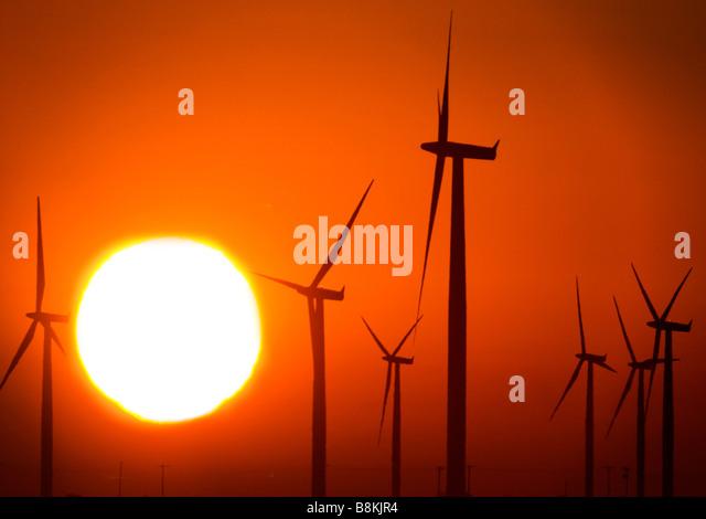 Sunrise and wind turbines, Texas windfarm. - Stock Image