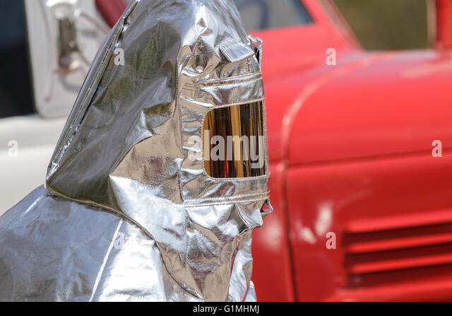 Fire in special heat resistant suit - Stock Image