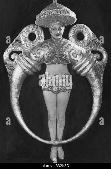 Portrait of woman in elaborate ring costume - Stock-Bilder
