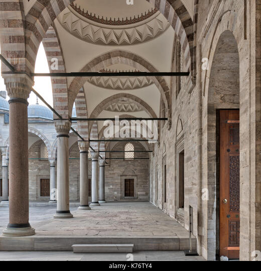 Passage leading to Sulaymaniye mosque, a public Ottoman Baroque style mosque, with columns, arches and marble floor, - Stock Image