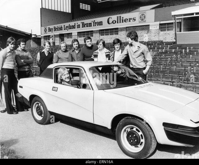 Birmingham City footballers looking at the new TR7 Sports car that one of them could win by getting the sixth goal - Stock Image