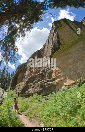 woman watching a rock climber in Southern Colorado, USA - Stock Image