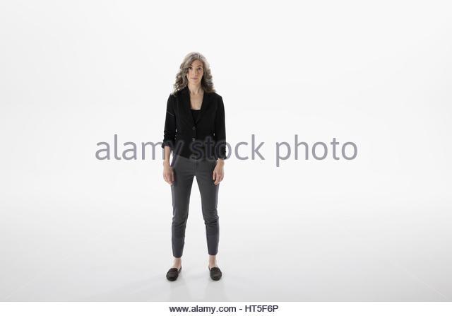 Portrait serious woman against white background - Stock-Bilder