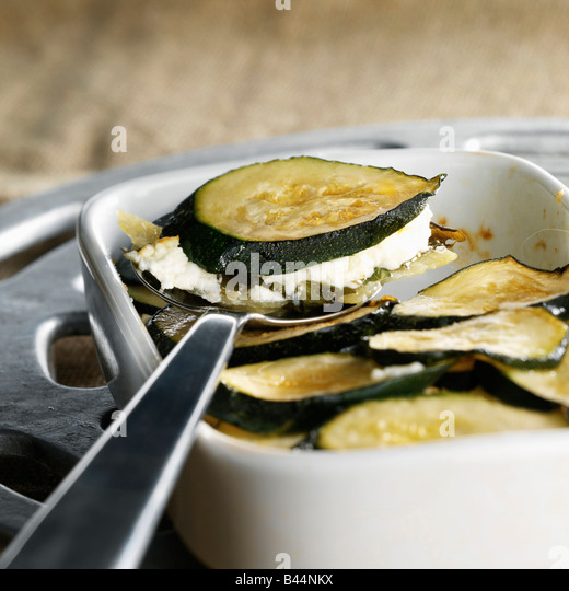 Courgette and goat's cheese gratin - Stock Image
