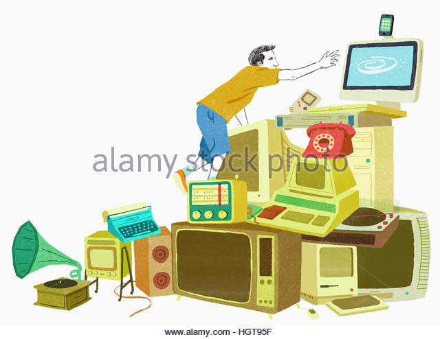 Man climbing over pile of old-fashioned, obsolete technology to reach modern computer - Stock-Bilder