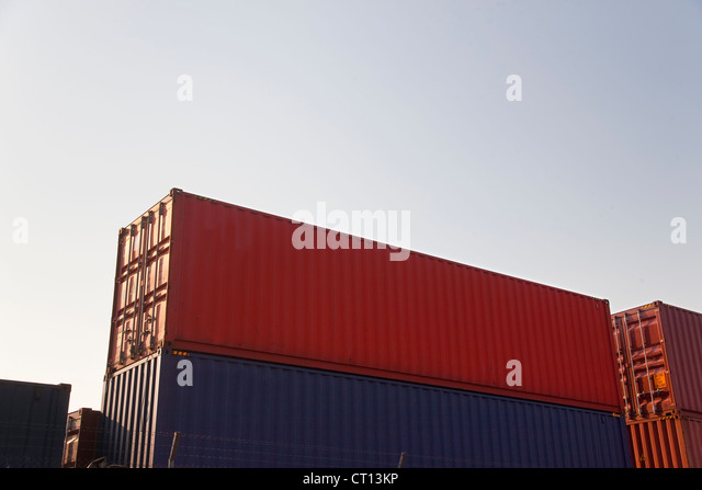 Low angle view of stacked containers - Stock Image