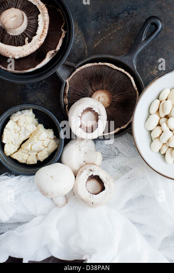 Pots of mushrooms with muslin - Stock Image