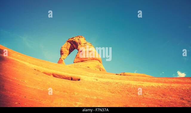 Retro toned Delicate Arch at sunset, Utah, USA. - Stock Image