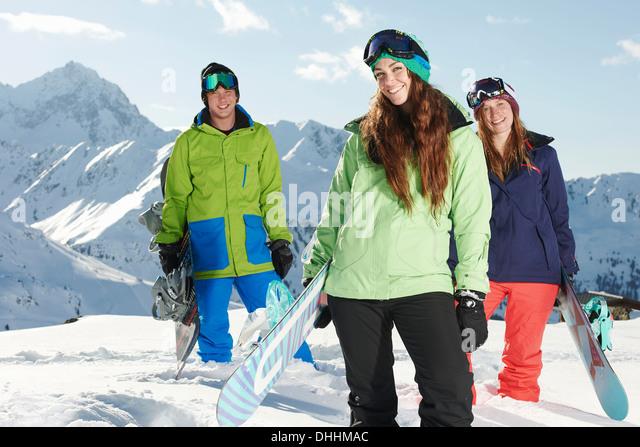 Friends holding snowboards, Kuhtai, Austria - Stock Image